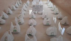 الهيئة الخيرية تستكمل مشروع توزع وجبات طعام للأسرة المتعففة في قطاع غزة