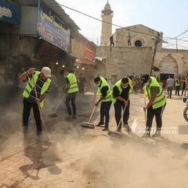 بالصور:حركة الجهاد الإسلامي تنظم حملة نظافة لسوق الزاوية
